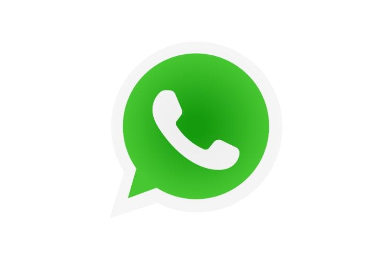 WhatsApp-Messenger-Logo. Mobilteil auf grünem Hintergrund